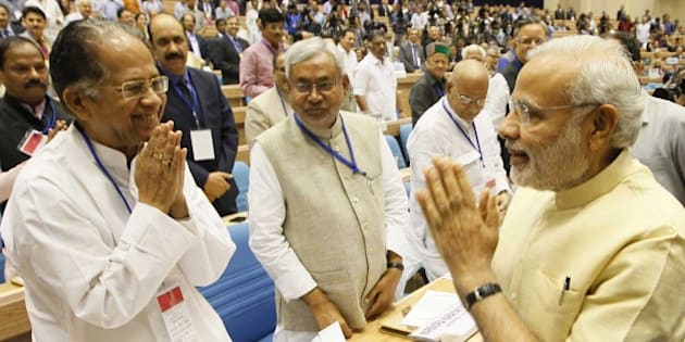 NEW DELHI, INDIA - APRIL 5: Prime Minister Narendra Modi, Chief Minister of Assam Tarun Gogoi and Chief Minister of Bihar Nitish Kumar during the joint conference of the Chief Ministers and the Chief Justices of High Courts at Vigyan Bhawan, on April 5, 2015 in New Delhi, India. Talking about judicial system, Modi said that what the people in judicial system do is divine and God has sent them to carry out this divine responsibility. We are going on increasing our power. But We also need to remember to become perfect even as we get more powerful. He urged the need for judges to evolve an in-built mechanism of self-correction to prevent rot from within. He further said that the common men's expectation from the judiciary is huge. (Photo by Arvind Yadav/Hindustan Times via Getty Images)