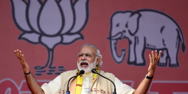 India's Prime Minister Narendra Modi gestures as he addresses an election rally at Majuli Island on March 26, 2016, ahead of state assembly elections in Assam.     Thousands of Indian voters will elect legislators for the 126 seats contested in 25,000 polling stations in the north-eastern state of Assam in two phases on April 4 and 11. / AFP / Biju BORO        (Photo credit should read BIJU BORO/AFP/Getty Images)