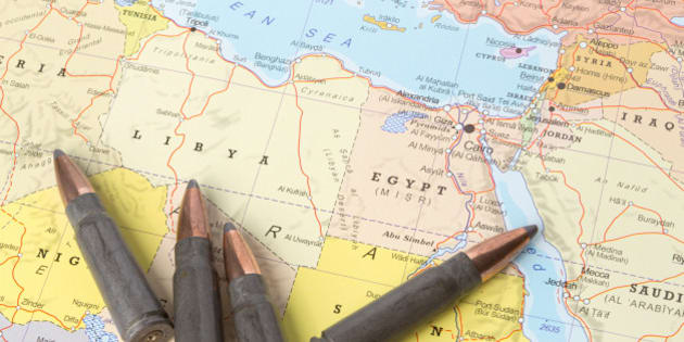 Four bullets on the geographical map of Libya and Egypt in North Africa. Conceptual image for war, conflict, violence.