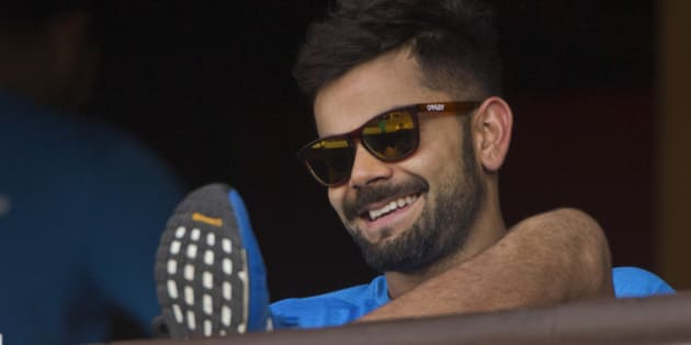 India's Virat Kohli smiles as he rests after a practice session ahead of their match against New Zealand in the ICC World Twenty20 2016 cricket tournament in Nagpur, India, Monday, March 14, 2016. (AP Photo/Saurabh Das)