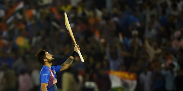 India's Virat Kohli celebrates after victory in the World T20 cricket tournament match between India and Australia at The Punjab Cricket Stadium Association Stadium in Mohali on March 27, 2016. / AFP / MONEY SHARMA        (Photo credit should read MONEY SHARMA/AFP/Getty Images)
