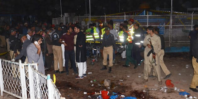 LAHORE, PUNJAB, PAKISTAN - 2016/03/27: (EDITORS NOTE: Image contains graphic content.) Pakistani rescuers and officials gather at a bomb blast site in Lahore. At least 52 people were killed and dozens injured when an explosion ripped through the parking lot of a crowded park where many minority Christians had gone to celebrate Easter Sunday, officials said. (Photo by Rana Sajid Hussain/Pacific Press/LightRocket via Getty Images)