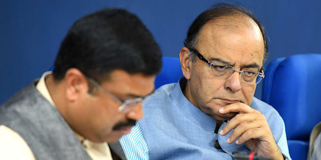 NEW DELHI, INDIA - MARCH 10: Finance Minister Arun Jaitley along with Minister of Petroleum and Natural Gas Dharmendra Pradhan, during the press conference at Cabinet briefing at Press Information Bureau at Shastri Bhawan on March 10, 2016 in New Delhi, India. Finance Minister raked up the Bofors case reminding Rahul Gandhi of Ottavio Quattrocchi's escape to hit back at him for his attack on the government over liquor baron Vijay Mallya leaving the country despite owing over Rs. 9,000 crore to banks. (Photo by Raj K Raj/Hindustan Times via Getty Images)