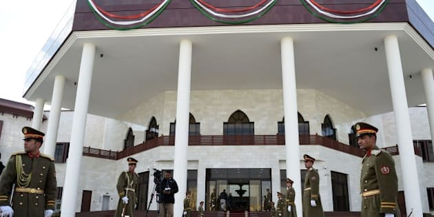 An Afghan guard of honour stands to attention prior to the ribbon-cutting ceremony of the inauguration of the new Parliament complex in Kabul on December 25, 2015.   Modi, on his visit to Kabul, inaugurated a swanky new parliament complex at an estimated 90 million dollars and gifted three Russian-made attack helicopters to the Afghan government.  AFP PHOTO / Wakil Kohsar / AFP / WAKIL KOHSAR        (Photo credit should read WAKIL KOHSAR/AFP/Getty Images)