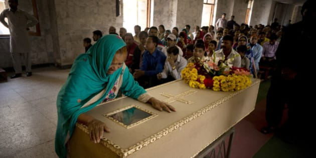 The grandmother of Pakistani Christian boy Sahil Pervez, mourns his death, at a church in Lahore, Pakistan, Monday, March 28, 2016. The death toll from a massive suicide bombing targeting Christians gathered on Easter in the eastern Pakistani city of Lahore rose on Monday as the country started observing a three-day mourning period following the attack. (AP Photo/B.K. Bangash)