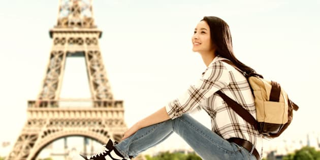 Young woman traveling in Paris France