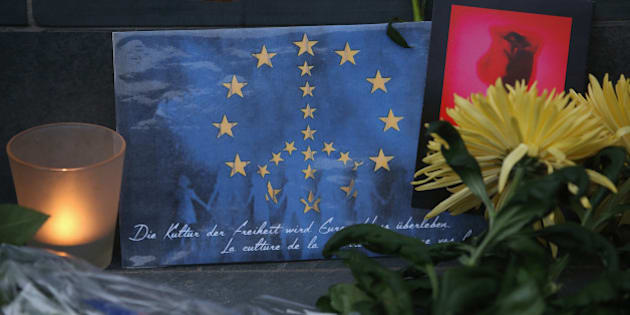 BERLIN, GERMANY - MARCH 22:  A peace sign combined with the flag of the European Union lies among flowers and a candle at the steps of the Belgian Embassy following today's terrorist attacks in Brussels on March 22, 2016 in Berlin, Germany. The Islamic State has claimed responsibility for the attack in which terrorists detonated three explosives devices at Brussels airport and in a metro train and killed at least 30 people.  (Photo by Sean Gallup/Getty Images)