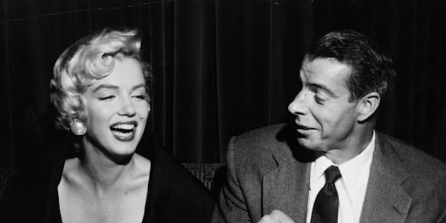 "Joe makes a hit - Joe di Maggio draws a big smile from his movie-star wife Marilyn Monroe at the El Morocco restaurant in New York City late Sept. I2, 1954. Happy couple was dining with friends after Joe flew in from the west coast to join the ""Mrs. Marilyn is in town"" to make street scenes in Manhattan for her new picture, ""the seven year itch"". (AP Photo)"