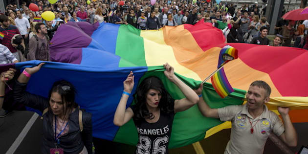 Participants hold a rainbow flag during the annual gay pride parade march in Belgrade, Serbia, September 20, 2015. REUTERS/Marko Djurica