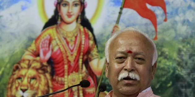 "NEW DELHI, INDIA - NOVEMBER 22: Rashtriya Swayamsevak Sangh (RSS) Chief Mohan Bhagwat speaks during the condolence meeting of former Vishwa Hindu Parishad (VHP) President Ashok Singhal, in New Delhi, India, on Sunday, November 22, 2015. Singhal died at the age of 89 on November 17, 2015. Bhagwat said, ""Ashok ji was a pillar of unity and strength for Hindus. He has not gone but is still there in us in our memories and will continue to guide us."" (Photo by Sanjeev Verma/Hindustan Times via Getty Images)"