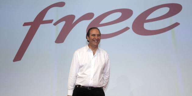French provider of phone, Internet and TV services group Iliad SA's chairman Xavier Niel smiles during a press conference in Paris, Tuesday March 10, 2015. Niel announced   the imminent arrival of the latest over-the-top triple play box, the Free Mini 4K.  (AP Photo/Remy de la Mauviniere)