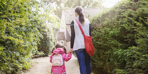 Mother and daughter walking to school.