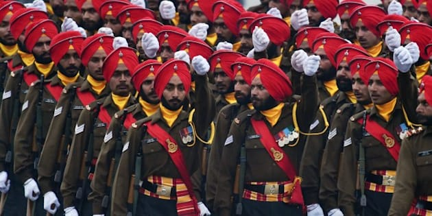 Members of the Indian Army Sikh Regiment march during the country's Republic Day parade in New Delhi on January 26, 2015. Rain failed to dampen spirits at India's Republic Day parade January 26 as US President Barack Obama became the first US president to attend the spectacular military and cultural display in a mark of the nations' growing closeness.  AFP PHOTO / Roberto SCHMIDT        (Photo credit should read ROBERTO SCHMIDT/AFP/Getty Images)