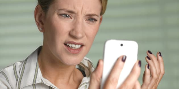 Unhappy woman on smart phone