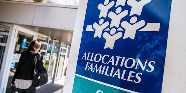 A woman walks past a branch of the Caisse d'Allocations Familiales (Family Allocations Office, or CAF) in Calais on April 15, 2015.   AFP PHOTO PHILIPPE HUGUEN        (Photo credit should read PHILIPPE HUGUEN/AFP/Getty Images)