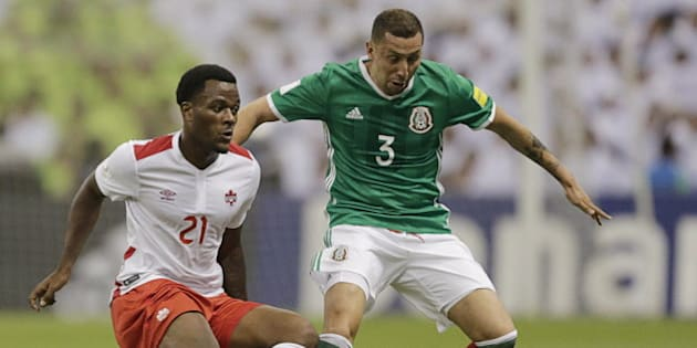 Football Soccer - Mexico v Canada - World Cup 2018 Qualifier - Azteca Stadium, Mexico City, Mexico - 29/3/16. Yasser Corona (3) of Mexico and Cyle Larin of Canada in action. REUTERS/Henry Romero