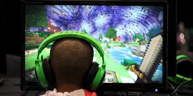 A child plays video game Minecraft at the Minecon convention in London July 4, 2015. The 10,000 tickets sold for Minecon in London made it the largest ever convention for a single video game. REUTERS/Matthew Tostevin