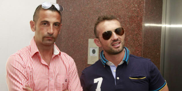 Italian sailors Massimiliano Latorre (L) and Salvatore Girone wait to board an elevator to reach the police commissioner's office in the southern Indian city of Kochi December 18, 2012. Italy's Defense Minister Giampaolo Di Paolo on Sunday visited two Italian marines accused of killing two fishermen off the coast of Kerala, stepping up pressure to allow the men home for Christmas after the case flared into a diplomatic spat. The sailors, members of a military security team protecting the cargo ship Enrica Lexie from pirate attacks, open fired on a fishing boat they mistook for a pirate craft in February. The killings of the unarmed fishermen triggered outrage in India. REUTERS/Sivaram V (INDIA - Tags: POLITICS MILITARY)