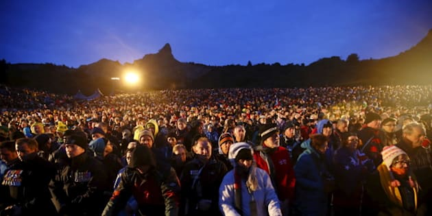 Visitors from Australia and New Zealand attend a dawn ceremony marking the 100th anniversary of the Battle of Gallipoli, at Anzac Cove in Gallipoli April 25, 2015. The battle on Turkey's Gallipoli peninsula was one of the bloodiest of the Great War, as thousands of soldiers from the Australian and New Zealand Army Corps (ANZAC) were cut down by machinegun and artillery fire as they struggled ashore on a narrow beach.The fighting would eventually claim more than 130,000 lives, 87,000 of them on the Ottoman side, before the Turks finally repulsed the poorly planned Allied campaign. REUTERS/Osman Orsal
