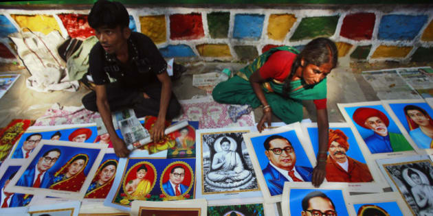 Indian street vendors display portraits of Bhim Rao Ambedkar, wearing the glasses, on his death anniversary in Mumbai, India, Friday, Dec. 6, 2013. Ambedkar, an untouchable, or dalit, and a prominent Indian freedom fighter, was the chief architect of the Indian Constitution, which outlawed discrimination based on caste. (AP Photo/Rafiq Maqbool)