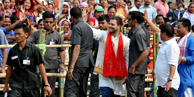 Rahul Gandhi, vice-president of the Indian National Congress party, waves to the crowd at an election rally in Diphu in Karbi Anglong on March 29, 2016, ahead of state assembly elections in Assam.  Thousands of Indian voters will elect legislators for the 126 seats contested in 25,000 polling stations in the northeastern state of Assam in two phases on April 4 and 11. / AFP / Biju BORO        (Photo credit should read BIJU BORO/AFP/Getty Images)