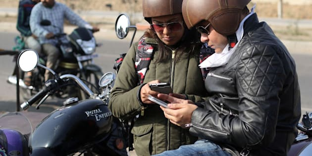NEW DELHI, INDIA - FEBRUARY 22: Women and men from an assortment of biker gangs across New Delhi are pictured joining forces to campaign for female empowerment on February 22, 2015 in New Delhi, India.  Over 100 bikers, including 25 women bikers, took part in a 'Mission Hazaar' rally involving a 200km round trip from Delhi to Rothak in the state of Haryana to raise awareness about gender biased sex selection and honour killing of women in same clan marriages.  PHOTOGRAPH BY Susannah Ireland / Barcroft Media (Photo credit should read Susannah Ireland / Barcroft Indi via Getty Images)