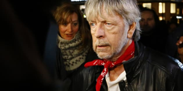 French singer Renaud pays tribute on the Place de la Republique during a gathering that marks one year after the attacks on Charlie Hebdo satirical newspaper, in Paris, France, Thursday, Jan. 7, 2016. It's a year to the day since an attack on the French satirical newspaper Charlie Hebdo launched a bloody year in the French capital. Tensions in France, under a state of emergency since a wave of attacks on Nov. 13, have been even higher this week as the anniversary of the January attacks approached. (AP Photo/Francois Mori)