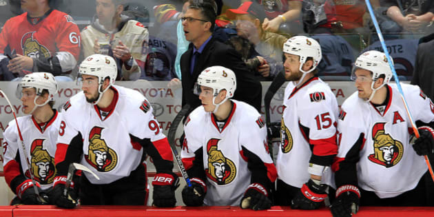 WINNIPEG, MB - MARCH 30: Head Coach Dave Cameron of the Ottawa Senators looks on from the bench behind the player during second period action against the Winnipeg Jets at the MTS Centre on March 30, 2016 in Winnipeg, Manitoba, Canada. (Photo by Darcy Finley/NHLI via Getty Images)