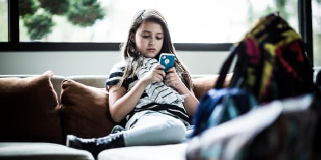 girl (9) using smartphone