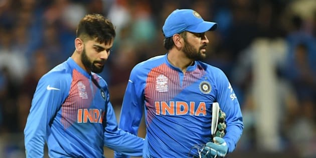 India's Virat Kohli(L)and captain Mahendra Singh Dhoni look on after defeat in the World T20 cricket tournament second semi-final match between India and West Indies at The Wankhede Stadium in Mumbai on March 31, 2016.   / AFP / INDRANIL MUKHERJEE        (Photo credit should read INDRANIL MUKHERJEE/AFP/Getty Images)