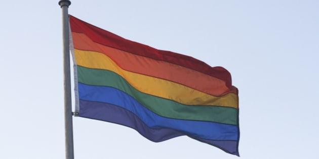 Rainbow flag blowing in wind