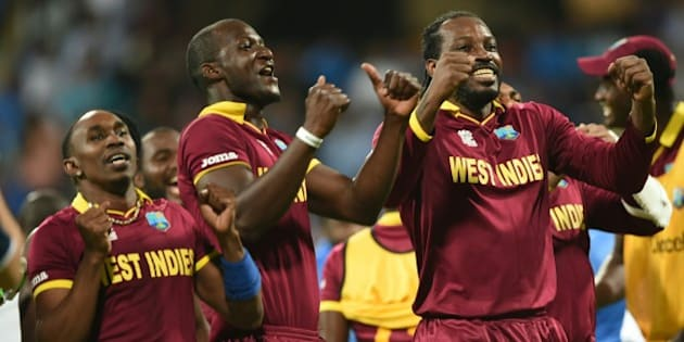 West Indies's captain Darren Sammy(C) Dwayne Bravo(L)and Chris Gayle(R)celebrate after victory in the World T20 cricket tournament second semi-final match between India and West Indies at The Wankhede Stadium in Mumbai on March 31, 2016.   / AFP / INDRANIL MUKHERJEE        (Photo credit should read INDRANIL MUKHERJEE/AFP/Getty Images)