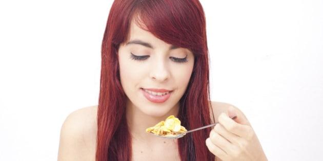 Teen eating cerealTeen eating cereal