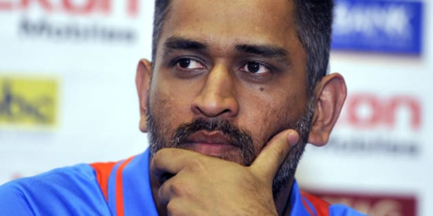 Indian cricket team captain Mahendra Sing Dhoni listens to a question during a unveiling ceremony of Celkon Tri-Nation series cup in Kingston on June 27, 2013. Sri Lanka will face West Indies in the first match of a Tri Nation series involving India too. AFP PHOTO/Jewel Samad        (Photo credit should read JEWEL SAMAD/AFP/Getty Images)