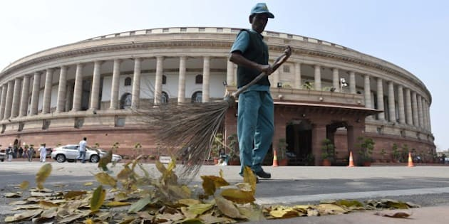 NEW DELHI, INDIA - MARCH 8: A Sweeper cleans at Parliament House on the occasion of International Women's Day during the Parliament Budget Session on March 8, 2016 in New Delhi, India. After huge criticism, Finance Minister Arun Jaitley announced roll back of its Budget proposal of imposing a tax on Employees' Provident Fund withdrawals. (Photo by Sonu Mehta/Hindustan Times via Getty Images)