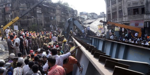 KOLKATA, WEST BENGAL, INDIA - 2016/03/31: At least 22 people have been killed and several injured after an under construction flyover collapsed in near Ganesh Talkies ( Girish Park), North Kolkata.  Several people are still trapped under the debris. West Bengal Chief Minister Mamata Banerjee cancelled her political rally for upcoming state legislative election and superintendence the rescue operation. (Photo by Saikat Paul/Pacific Press/LightRocket via Getty Images)