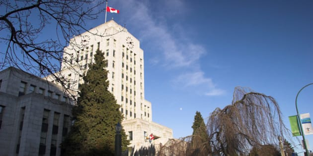 Vancouver City Hall landscape with canada Flag on clear winter day - Vancouver BC