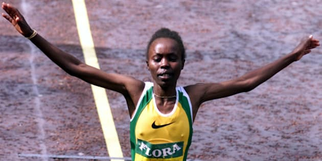 Kenya's Tegla Loroupe raises her arms in celebration as she crosses the finish line to win the women's London marathon April 16. Loroupe won her first London title in an unofficial two hours 24 minutes 33 seconds.  IW