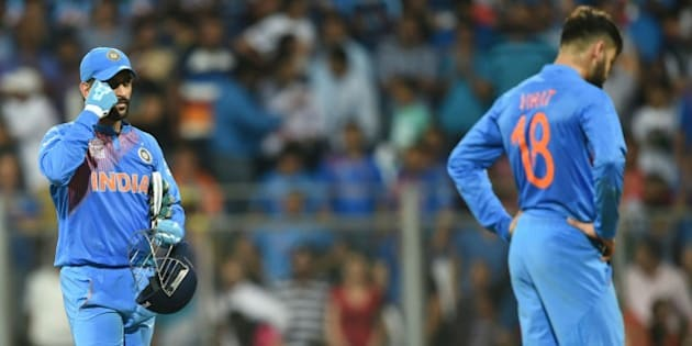India's captain Mahendra Singh Dhoni(L) and teammate Virat Kohli react after defeat in the World T20 men's semi-final match between India and West Indies at the Wankhede stadium in Mumbai on March 31, 2016. / AFP / INDRANIL MUKHERJEE        (Photo credit should read INDRANIL MUKHERJEE/AFP/Getty Images)