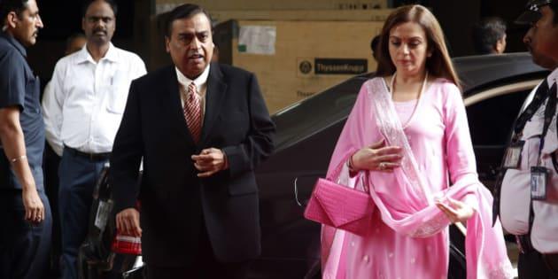 Mukesh Ambani, chairman and managing director of the Reliance Industries Ltd., and his wife Nita arrive for the 41st Reliance Industries AGM meet in Mumbai, India, Friday, June 12, 2015. (AP Photo/Rajanish Kakade)
