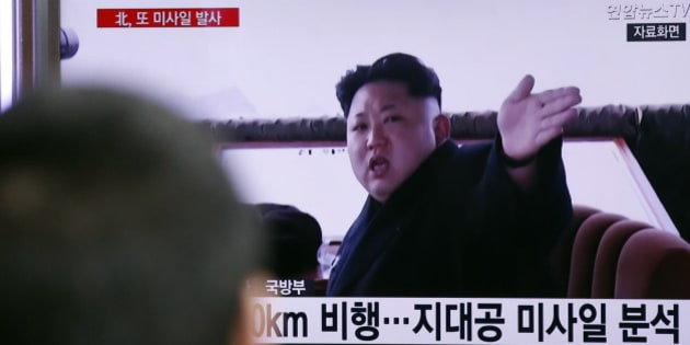 """A man watches a TV news program showing a file footage of North Korean leader Kim Jong Un at Seoul Railway Station in Seoul, South Korea, Friday, April 1, 2016. North Korea fired a short-range missile into the sea on Friday, Seoul officials said, hours after the U.S., South Korean and Japanese leaders warned the North it will face tougher sanctions if it continues with provocations. The Korean letters at bottom read: """"Analysis, the surface-to-air missile."""" (AP Photo/Lee Jin-man)"""