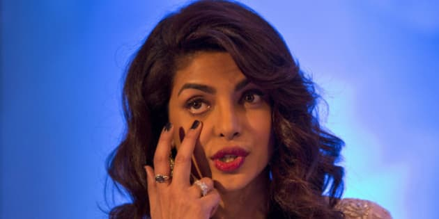 Indian Bollywood actor and UNICEF Goodwill Ambassador, Priyanka Chopra gestures to describe anemia as she speaks during the launch of a media campaign of Weekly Iron and Folic Acid Supplement (WIFS) Program in New Delhi, India, Wednesday, Dec. 23, 2015. (AP Photo /Tsering Topgyal)