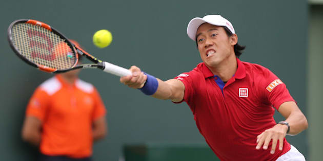 Japan's Kei Nishikori returns a shot against Serbia's Novak Djokovic in the finals of the Miami Open on Sunday, April 3, 2016, at Cradon Park Tennis Center in Key Biscayne, Fla. Djokovic won, 6-3, 6-3. (Carl Juste/Miami Herald/TNS via Getty Images)
