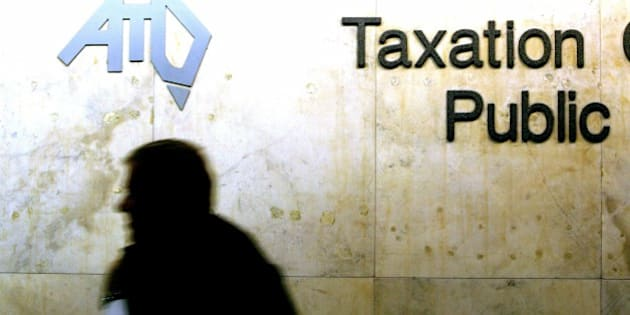 Bhp billiton and wilson security linked to panama papers australia new zealand out a human shadow is visible under the australian taxation malvernweather Images