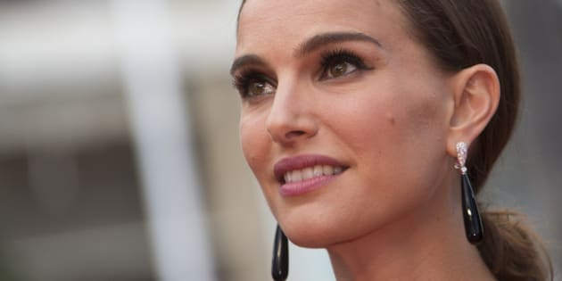 """Actress and director Natalie Portman poses on the red carpet as she arrives for the screening of the film """"Sicario"""" in competition at the 68th Cannes Film Festival in Cannes, southern France, May 19, 2015.          REUTERS/Yves Herman"""