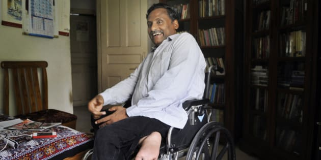 NEW DELHI, INDIA - JULY 6: Professor GN Saibaba during an interview at his residence in the Delhi University North Campus on July 6, 2015 in New Delhi, India. A lecturer in the English Department, he was arrested by Maharashtra Police last year for alleged Maoist links and jailed in the Nagpur Central Prison.  He was granted bail for three months by the Mumbai High Court so that he could consult doctors for several ailments. (Photo by Sushil Kumar/Hindustan Times via Getty Images)