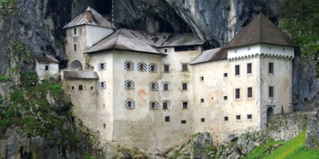 Predjama Castle in Slovenia is characterized by being built into the mouth of a cave, as you can see in the picture.It is also surrounded by green meadows, which make it unique.
