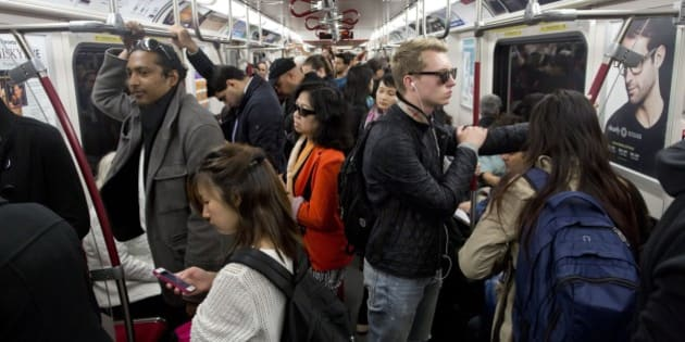 TORONTO, ON - OCTOBER 7:  TTC riders aboard the Yonge subway line for Toronto Star story on election issues. TTC subway rush-hour traffic pedestrians Toronto.        (Lucas Oleniuk/Toronto Star via Getty Images)