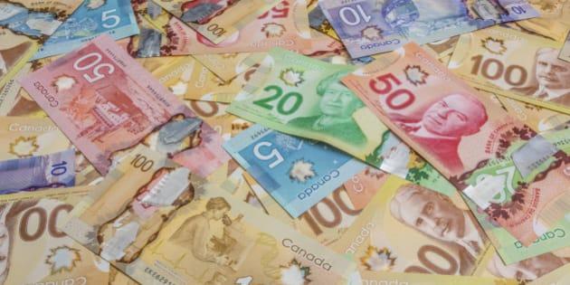 Canadian dollar bills spread out.