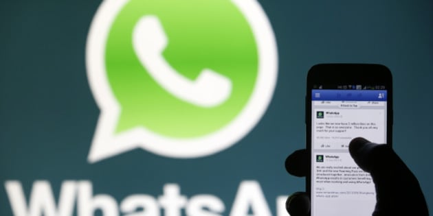 A Whatsapp App logo is seen behind a Samsung Galaxy S4 phone that is logged on to Facebook in the central Bosnian town of Zenica, February 20, 2014. Facebook Inc will buy fast-growing mobile-messaging startup WhatsApp for $19 billion in cash and stock in a landmark deal that places the world's largest social network closer to the heart of mobile communications and may bring younger users into the fold. REUTERS/Dado Ruvic (BOSNIA AND HERZEGOVINA - Tags: BUSINESS)